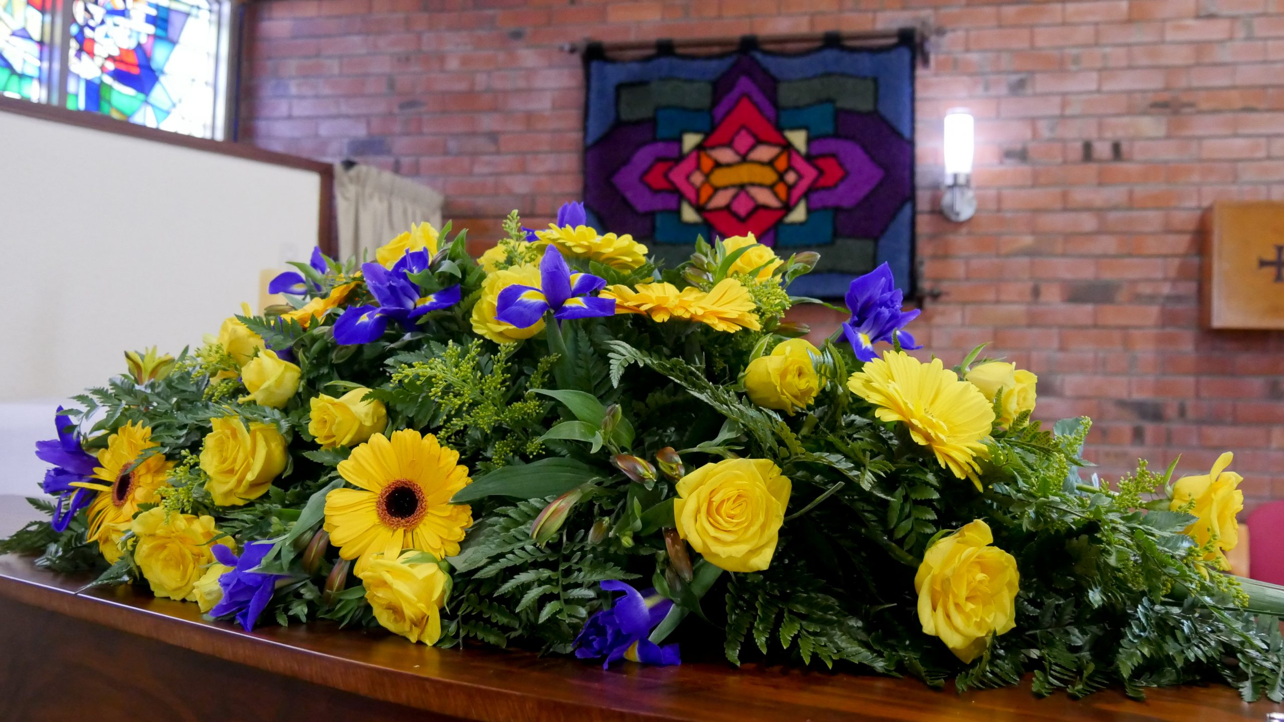 Funerals - Yellow flowers on coffin